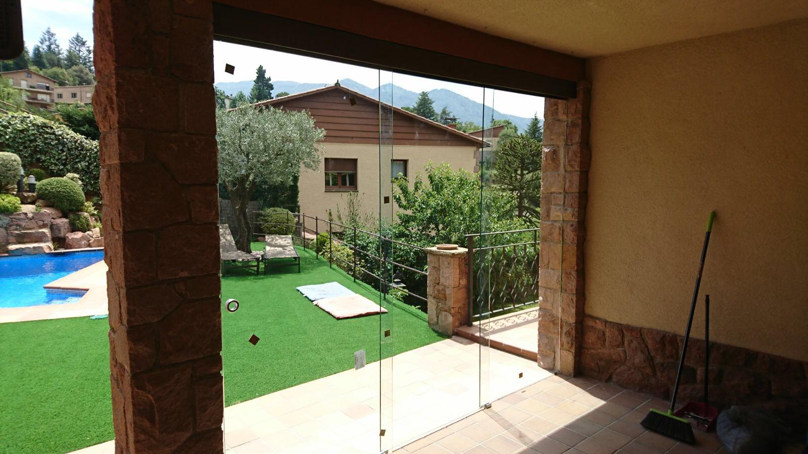 Puerta de vidrio laminado corredera hermanos almansa for Correderas de vidrio